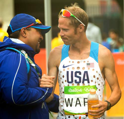 Rick Egan  |  The Salt Lake Tribune  Former BYU runner Jared Ward gets a hug from Physiotherapist, Bill Ito, after placing 6th in the Olympic Marathon,  in Rio de Janeiro, Sunday, August 21, 2016.