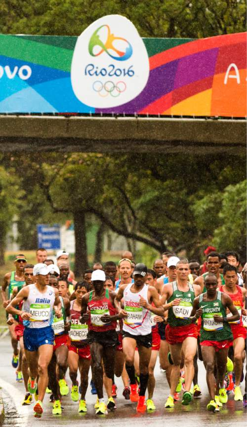 Rick Egan  |  The Salt Lake Tribune  Former BYU runner Jared Ward runs in the middle of the leader group at Km 6, in the pouring rain, near Marina Da Gloria, in the Olympic Marathon, Sunday, August 21, 2016.