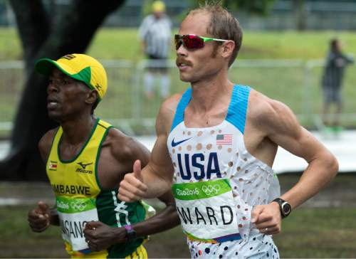 Rick Egan  |  The Salt Lake Tribune  Former BYU runner Jared Ward runs alongside Cuthbert Nayasango, Zimbabwe, near Marina Da Gloria, in the Olympic Marathon, in Rio de Janeiro. Ward finished in 6th place. Sunday, August 21, 2016.