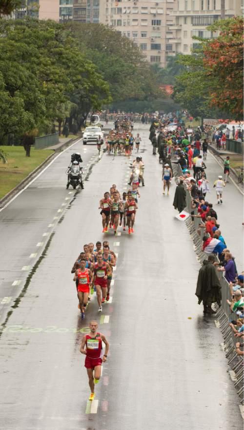 Rick Egan  |  The Salt Lake Tribune  Runners make their way down the wet streets of Rio de Janeiro in the men's Marathon, on a rainy Sunday morning, August 21, 2016.
