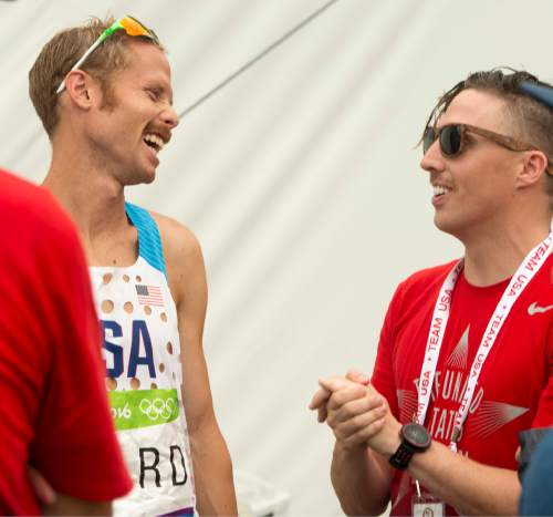 Rick Egan  |  The Salt Lake Tribune  Jared Ward shares a laugh withDan Jones, a friend from Utah sporting a mustache in support of Jared who placed 6th in todays  Olympic Marathon, in Rio de Janeiro, Sunday, August 21, 2016.