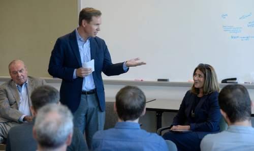 Al Hartmann  |  The Salt Lake Tribune  Publisher Paul Huntsman introduces former reporter Jennifer Napier-Pearce, right, as the new editor for The Salt Lake Tribune in a  staff meeting Monday August 22, 2016. Chairman Emeritus Jon Huntsman Sr. listens in behind.