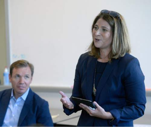 Al Hartmann  |  The Salt Lake Tribune  Jennifer Napier-Pearce, new editor of the Salt Lake Tribune, speaks to staff on Monday August 22, 2016. Paul Huntsman listens in behind.
