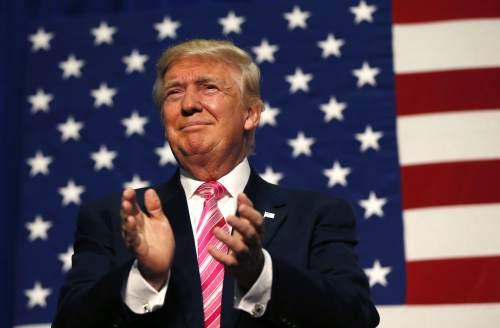 Republican presidential candidate Donald Trump arrives to speak at a campaign rally in Fredericksburg, Va., Saturday, Aug. 20, 2016. (AP Photo/Gerald Herbert)