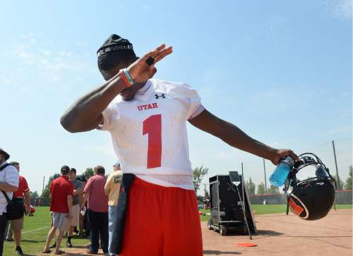 Scott Sommerdorf   |  The Salt Lake Tribune   Utah QB Tyler Huntley playfully dabs after coming off the practice field, Thursday, August 4, 2016.