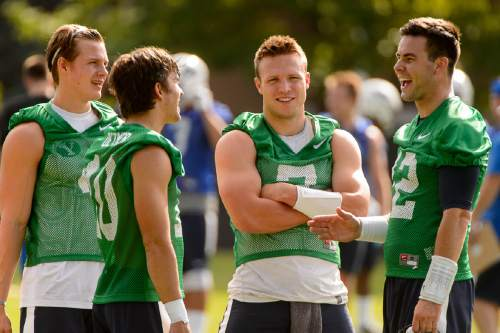 Trent Nelson     The Salt Lake Tribune BYU quarterbacks Beau Hoge, Koy Detmer Jr., Tanner Mangum, and Taysom Hill at the first BYU fall camp practice under new coach Kalani Sitake, Friday August 5, 2016 in Provo.