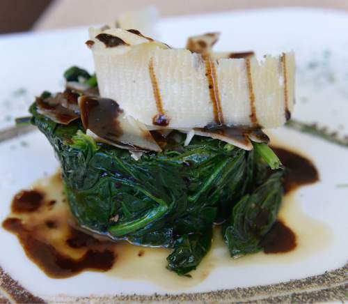 Al Hartmann  |  The Salt Lake Tribune  Spinaci al burro, sauteed fresh spinach topped with shaved parmesean and balsamic, at Sicilia Mia in Millcreek.