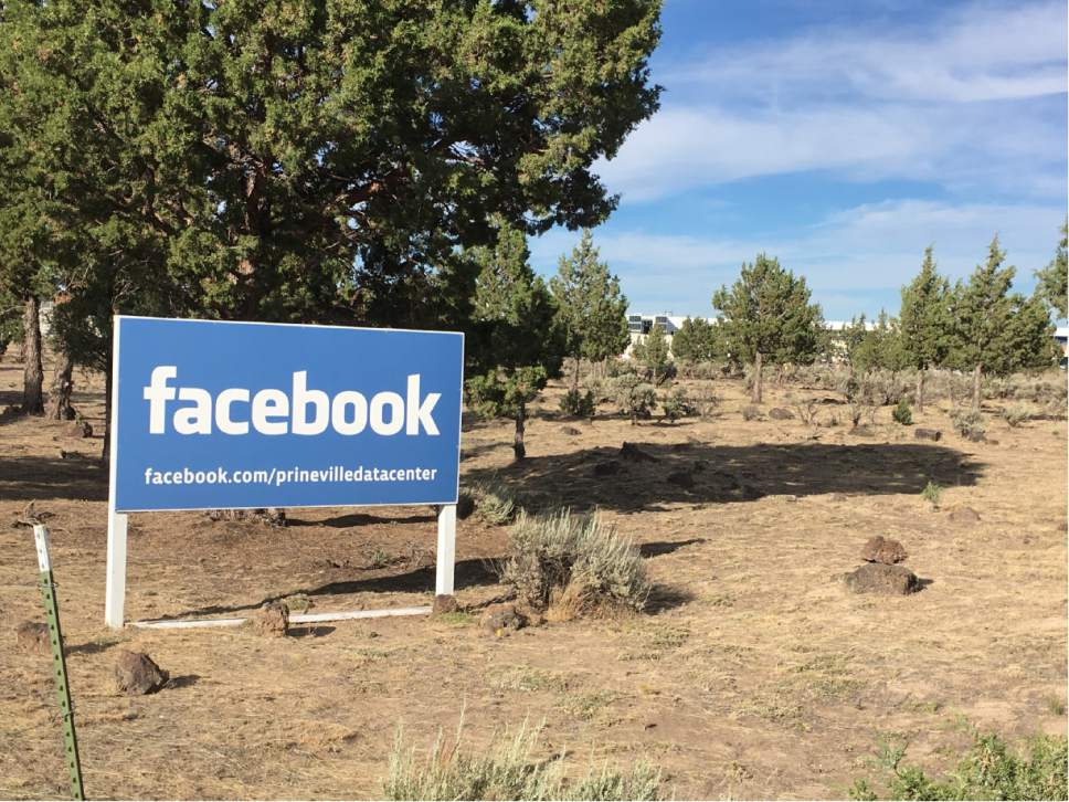 In this July 1, 2016 photo, a sign shows the entrance to the Facebook Data Center in Prineville, Ore. When timber was king, Crook County was the nation's top producer of ponderosa lumber. But with the catastrophic decline in the timber industry, and the global recession after that, suddenly the digital revolution is providing the county and its main town, Prineville, with a rare second chance. (AP Photo/Andrew Selsky)