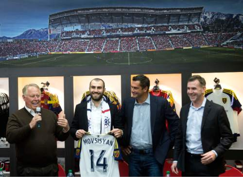 Steve Griffin  |  The Salt Lake Tribune   RSL owner Dell Loy Hansen, left, introduces Yura Movsisyan as the 28-year-old striker returns to his former club after six seasons overseas in one of the most notable signings in club history at the Real Salt Lake store in Salt Lake City, Tuesday, January 19, 2016.