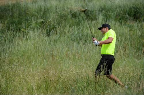 Francisco Kjolseth | The Salt Lake Tribune Jordan Rodgers pulls up the long grass as along the edge of hole #8 and getting back on track for the State Amateur golf tournament at Soldier Hollow on Friday, July 10, 2015.