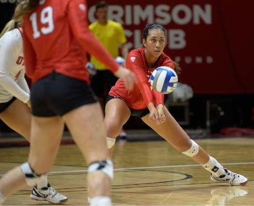 Francisco Kjolseth | The Salt Lake Tribune Utah's Adora Anae returns a serve as they host No. 9 BYU in the annual meeting between the schools' women's volleyball teams.