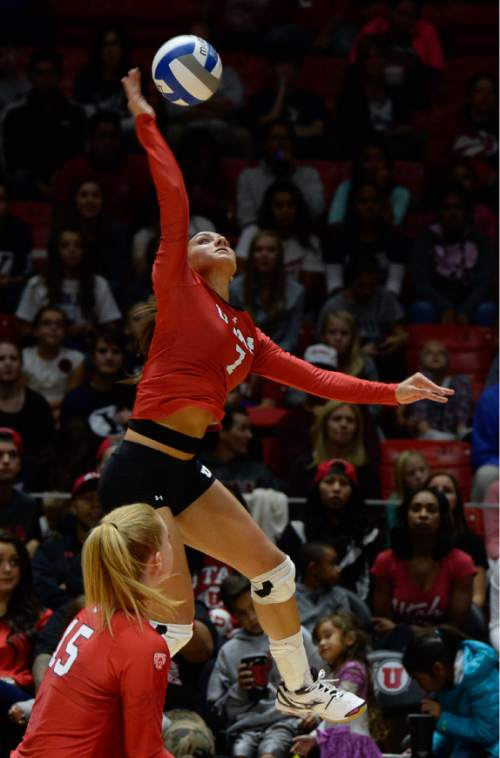 Francisco Kjolseth | The Salt Lake Tribune Utah's Eliza Katoa reaches high for a shot as they host No. 9 BYU in the annual meeting between the schools' women's volleyball teams.