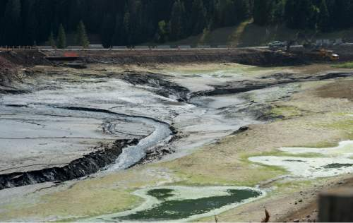 Steve Griffin / The Salt Lake Tribune  The drained Tibble Fork Reservoir in American Fork Canyon Monday August 22, 2016. The reservoir has been emptied because of the Tibble Fork Dam Rehabilitation Project. The American Fork River was running black with silt as it flowed through the project.
