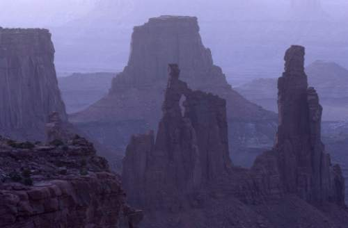 The view at dawn from Mesa Arch, in the Island in the Sky district of Canyonlands National Park. Photo by Trent Nelson; 07.09.2003, 5:38:23 AM