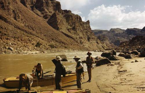 River runners unwind during a trip on the Green River in Cataract Canyon in Canyonlands National Park in 1947.