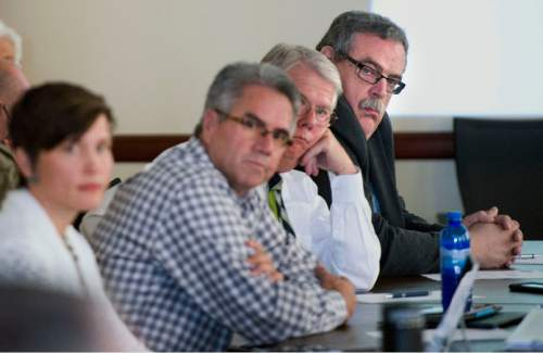 Steve Griffin / The Salt Lake Tribune  John Bennett, of the Quality Growth Commission, right, listens to the discussion as the commission holds a meeting involving Salt Lake City's authority to regulate land use in the Wasatch Front canyons. The meeting was held at the State Capitol, Senate Building in Salt Lake City Friday August 26, 2016.