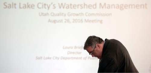 Steve Griffin / The Salt Lake Tribune  John Bennett, of the Quality Growth Commission, prepares a slide projector as the commission holds a meeting to discuss  a contentious issue involving Salt Lake City's authority to regulate land use in the Wasatch Front canyons. The meeting was held at the State Capitol, Senate Building in Salt Lake City Friday August 26, 2016.