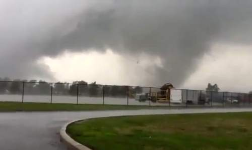 This image made from a video shows a tornado Wednesday, Aug. 24, 2016, in Kokomo, Ind. Multiple tornadoes touched down in central Indiana on Wednesday, tearing the roofs off apartment buildings, sending air conditioners falling onto parked cars and cutting power to thousands of people. (Bruce Robinson via AP)