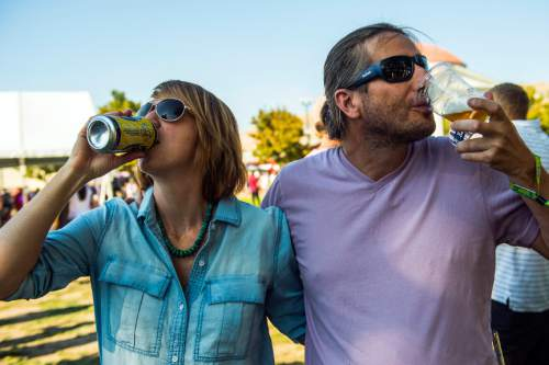 Chris Detrick  |  The Salt Lake Tribune Kelly and Alan Seim drink beer during the 7th annual Utah Beer Festival at the Utah State Fair Park on Saturday. The festival featured over 150 different beers and ciders.