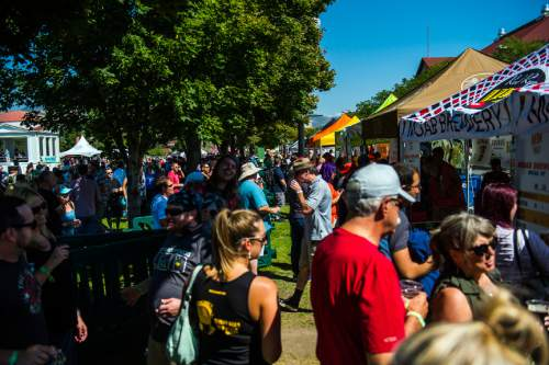 Chris Detrick  |  The Salt Lake Tribune Patrons enjoy their beer samples during the 7th annual Utah Beer Festival at the Utah State Fair Park Saturday August 27, 2016. The festival featured over 150 different beers and ciders.