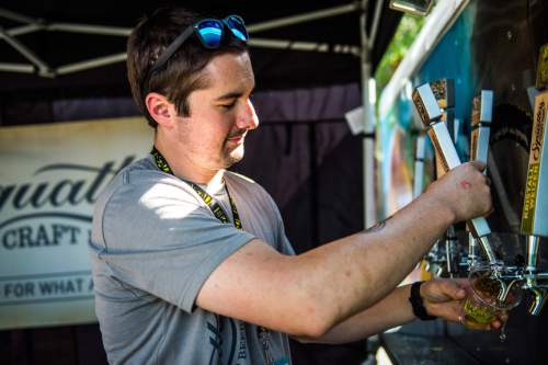 Chris Detrick  |  The Salt Lake Tribune Utah Brewers Cooperative brewer Nils Imboden pours beer during the 7th annual Utah Beer Festival at the Utah State Fair Park Saturday August 27, 2016. The festival featured over 150 different beers and ciders.