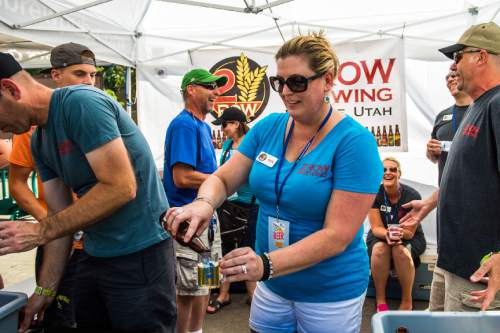 Chris Detrick  |  The Salt Lake Tribune 2 Row Brewing owner DeDe Coleman pours the Nemesis American Pale Ale during the 7th annual Utah Beer Festival at the Utah State Fair Park Saturday August 27, 2016. The festival featured over 150 different beers and ciders.