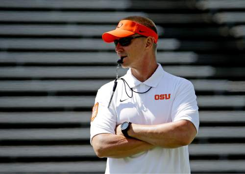 FILE - In this April 18, 2015, file photo, Oregon State football coach Gary Andersen watches during the first half of the NCAA college football team's spring game in Corvallis, Ore.  Andersen says that playing against Weber State  coach Jay Hill Friday for their season home opener makes him feel old.  (AP Photo/Don Ryan, file)