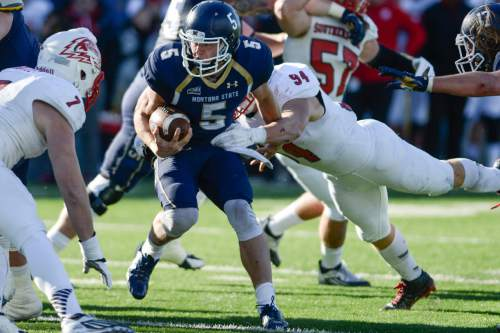 Montana State quarterback Dakota Prukop is tackled by Southern Utah linebacker Taylor Nelson during the first half of an NCAA college football game on Saturday, Nov. 7, 2015, in Bozeman, Mont. (Adrian Sanchez-Gonzalez/Bozeman Daily Chronicle via AP)