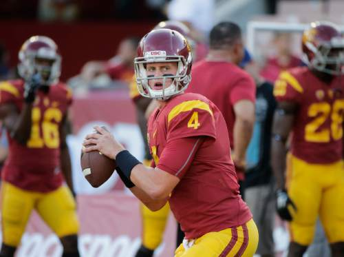 FILE - In this Oct. 8, 2015, file photo, Southern California quarterback Max Browne warms up before an NCAA college football game against Washington, in Los Angeles, Calif. (AP Photo/Jae C. Hong, File)