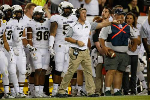 FILE - In this Sept. 19, 2015, file photo, Colorado head coach  Mike MacIntyre, center, looks on against the Colorado State Rams in the fourth quarter of an NCAA college football game Saturday in Denver, Colo.   Colorado and Oregon State play Saturday, Oct. 24, 2015,  in Corvallis, Ore., with each team hoping to avoid the Pac-12's basement. (AP Photo/David Zalubowski, file)