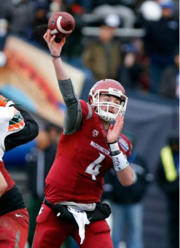 FILE - In this Dec. 26, 2015, file photo, Washington State quarterback Luke Falk throws in the Sun Bowl NCAA college football game against Miami in El Paso, Texas. (AP Photo/Andres Leighton, File)