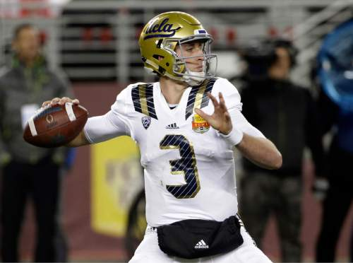 FILE- In this Dec. 26, 2015 file photo, UCLA quarterback Josh Rosen throws against Nebraska during the first half of the Foster Farms Bowl NCAA college football game, in Santa Clara, Calif. (AP Photo/Marcio Jose Sanchez, File)