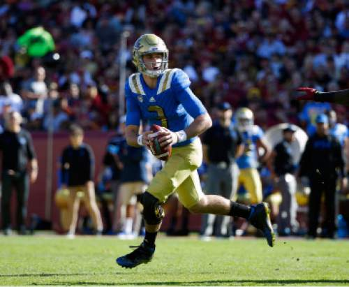 FILE - In this Nov. 28, 2015, file photo, UCLA quarterback Josh Rosen looks for a receiver during the first half of an NCAA college football game against Southern California, in Los Angeles. A new offensive scheme should mean bigger plays and more chances for Chosen Rosen to shine.  (AP Photo/Jae C. Hong, File)