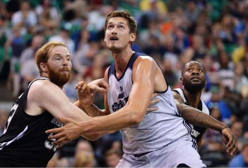 Steve Griffin / The Salt Lake Tribune  Utah Jazz center Tibor Pleiss, center battles Spurs center Alex Kirk  for position during the Jazz versus Spurs summer league game at the Vivint Smart Home Arena in Salt Lake City Monday July 4, 2016.