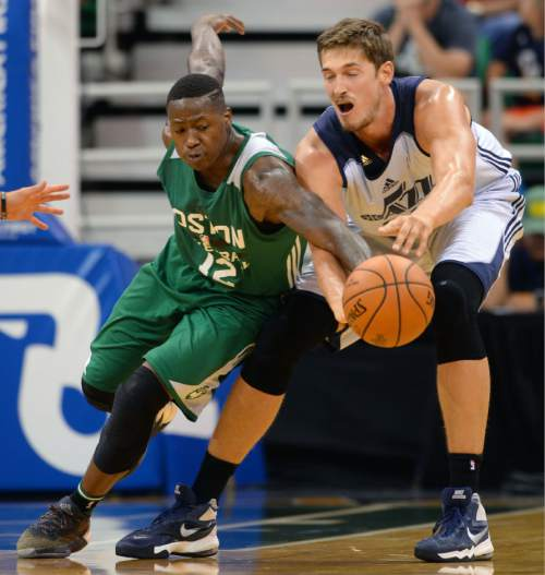 Steve Griffin / The Salt Lake Tribune  Boston's Terry Rozier, left, knocks the ball away from Utah Jazz center Tibor Pleiss during the Jazz versus Celtics summer league game at the Vivint Smart Home Arena in Salt Lake City Tuesday July 5, 2016.