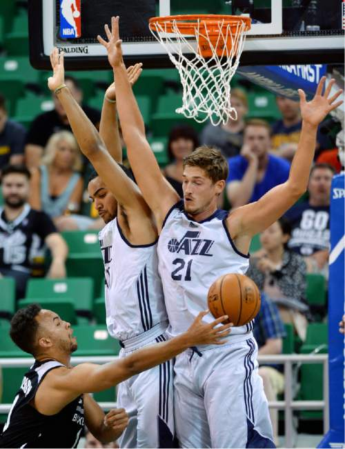 Steve Griffin / The Salt Lake Tribune  Utah Jazz forward Trey Lyles and center Tibor Pleiss block the path of Spurs  guard Kyle Anderson during the Jazz versus Spurs summer league game at the Vivint Smart Home Arena in Salt Lake City Monday July 4, 2016.