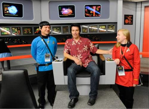"In this Saturday, Aug. 13, 2016 photo, Keith Schubert of Peru, N.Y., left, dressed as Star Trek's Mr. Spock, and his daughter Tiffany Schubert, right, talk with James Cawley, center, during a tour of his replica of the starship Enterprise from the original ""Star Trek"" series during the Trekonderoga festival in Ticonderoga, N.Y. (AP Photo/Hans Pennink)"