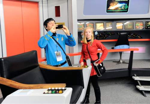 "In this Saturday, Aug. 13, 2016 photo, Keith Schubert, left, of Peru, N.Y., dressed as Star Trek's Mr. Spock, and his daughter Tiffany, right, dressed as a crew member, take photographs during a tour of the replica starship Enterprise from the original ""Star Trek"" series during the Trekonderoga festival in Ticonderoga, N.Y. (AP Photo/Hans Pennink)"