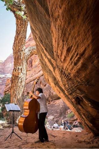 The Moab Music Festival returns for its 24th season Sept. 1-12 with a host of concerts, from Schubert and the Beatles to the sounds of Latin America, set against the southern Utah landscape. Pictured, a 2015 performance in Hunter Canyon. Richard Bowditch  |  Courtesy