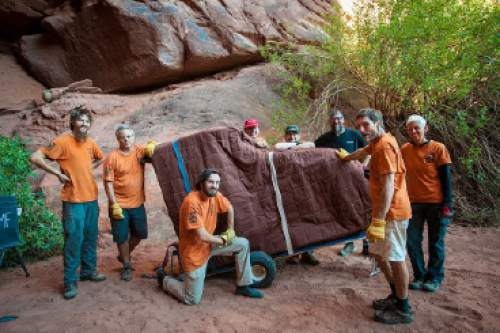 A grand piano makes its journey into the wild  in 2015 for one of the Moab Music Festival's signature grotto concerts. The festival returns for its 24th season this year Sept. 1-12. Richard Bowditch  |  Courtesy