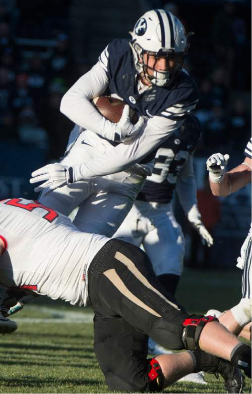 Rick Egan  |  The Salt Lake Tribune  Brigham Young Cougars defensive back Kai Nacua (12) is brought down by Fresno State Bulldogs offensive lineman Justin Northern (54), after intercepting a Bullldog pass,  as BYU defeated the The Fresno Bulldogs 52 -10, at Lavell Edwards stadium, Tuesday, November 21, 2015.
