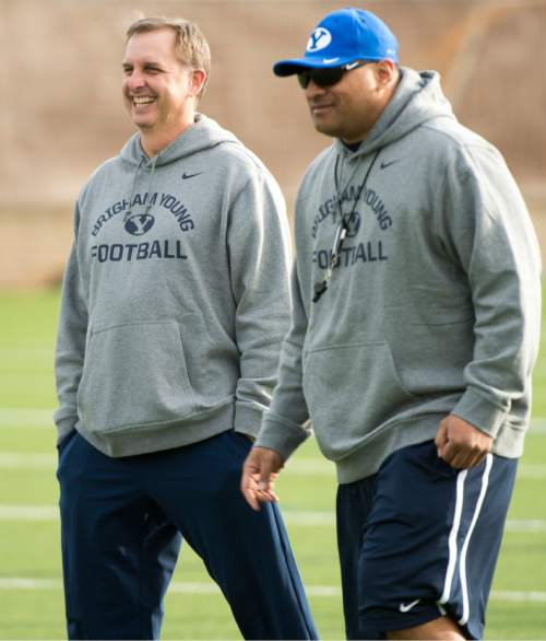 Rick Egan  |  The Salt Lake Tribune  BYU quarterback coach Ty Detmer and head coach Kalani Sitake  share a laugh with on the second day of spring practice, in Provo, Thursday, March 3, 2016.