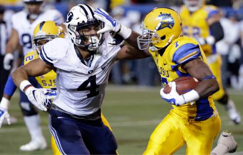 BYU linebacker Fred Warner (4) defends San Jose State running back Tyler Ervin (7) during the first half of an NCAA college football game Friday, Nov. 6, 2015, in San Jose, Calif. (AP Photo/Marcio Jose Sanchez)