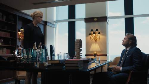 """Investment banker Naomi Bishop (Anna Gunn, left) reports to her boss, Randall (Lee Tergesen), in the financial thriller """"Equity."""" Courtesy Sony Pictures Classics"""