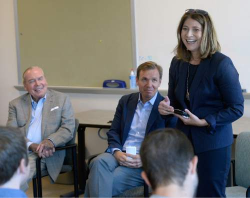 Al Hartmann  |  The Salt Lake Tribune  Jennifer Napier-Pearce, the new editor of the Salt Lake Tribune speaks to staff Monday August 22.  Publisher Emeritus Jon Huntsman Sr. and Publisher Paul Huntsman listen in behind.