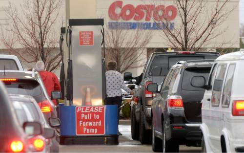 Al Hartmann  |  Tribune file photo Drivers line up for gas at Costco at 1800 S. 300 West in Salt Lake City. Cities complain they are not getting their fair share of the last gas-tax increase, prompting some to raise property taxes.