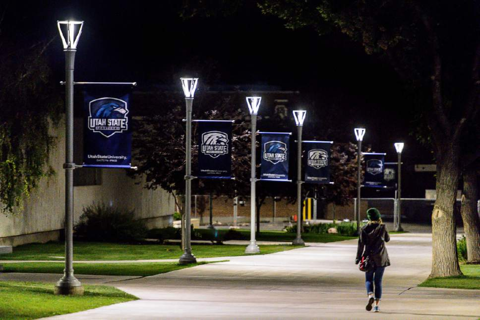 Trent Nelson  |  The Salt Lake Tribune A young woman walks along a lighted path at Utah State University Eastern in Price, Tuesday August 23, 2016.