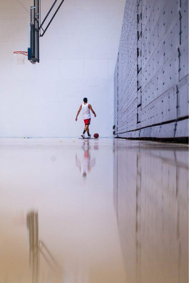 Trent Nelson  |  The Salt Lake Tribune A man works on his shot in the basketball gym in the Bunnell-Dmitrich Athletic Center  at Utah State University Eastern in Price, Tuesday August 23, 2016.
