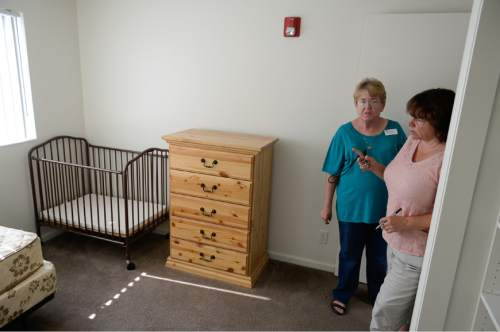 Francisco Kjolseth | The Salt Lake Tribune Bonnie Peters, left, Executive Director of the Family Support Center and Dawn Anderson, Property Manager for the housing project in Midvale, tour one of the vacant apartments available to single parents coming out of homelessness. The multi-faceted program, includes day-care facilities and lodgings with 54 units.
