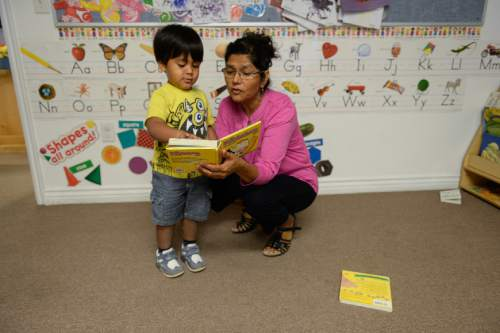 Francisco Kjolseth | The Salt Lake Tribune Marta Hernandez, Director of KidStart Daycare and Child Development Center in Midvale, reads a book to one of the children during a recent morning. The Family Support Center operates a multi-faceted program for single homeless mothers, which includes day-care facilities and lodgings to help them get back on their feet.